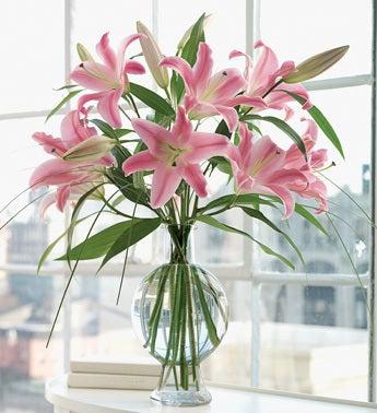 pink oriental lilies in fishbowl bottle vase
