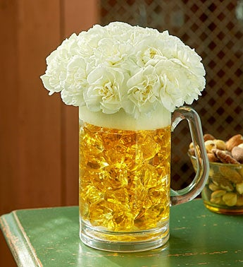 beer glass of mini carnations