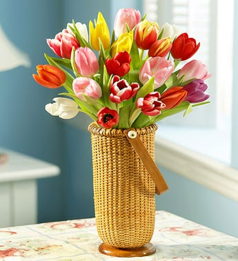 multicolored tulips in rattan vase