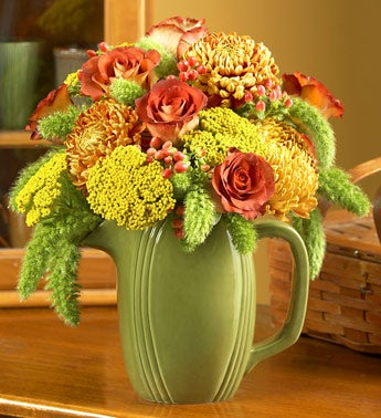 mums, roses, yarrow, hypericum in ceramic pitcher