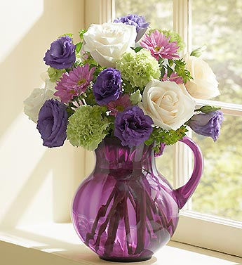 roses, carnations, daisy poms  in lavender pitcher