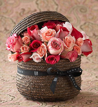pink roses in handsome wicker hatbox basket