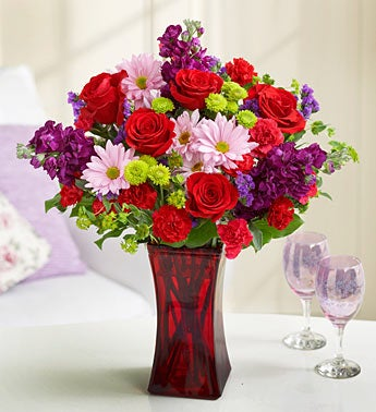 mixed pink and red bouquet in red cubed vase