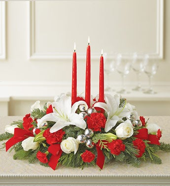 roses, carnations, liliy centerpiece with candles